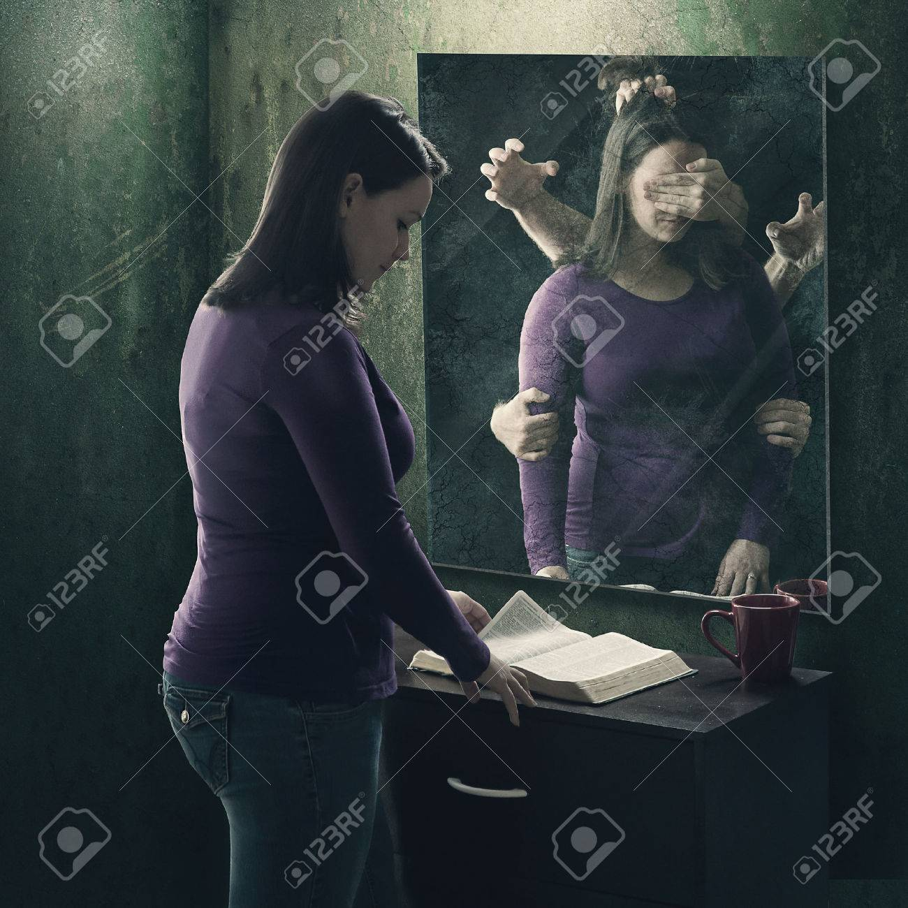 A woman reads her Bible as demons try to stop her - 57203779