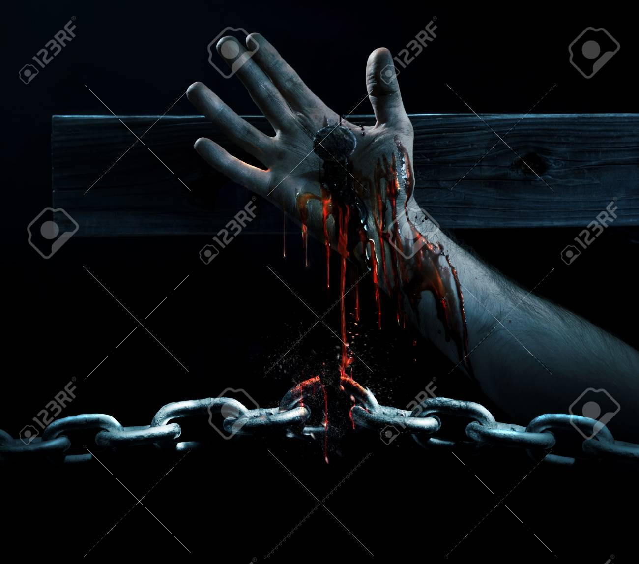 The blood of Jesus drips down and breaks a chain - 74918943