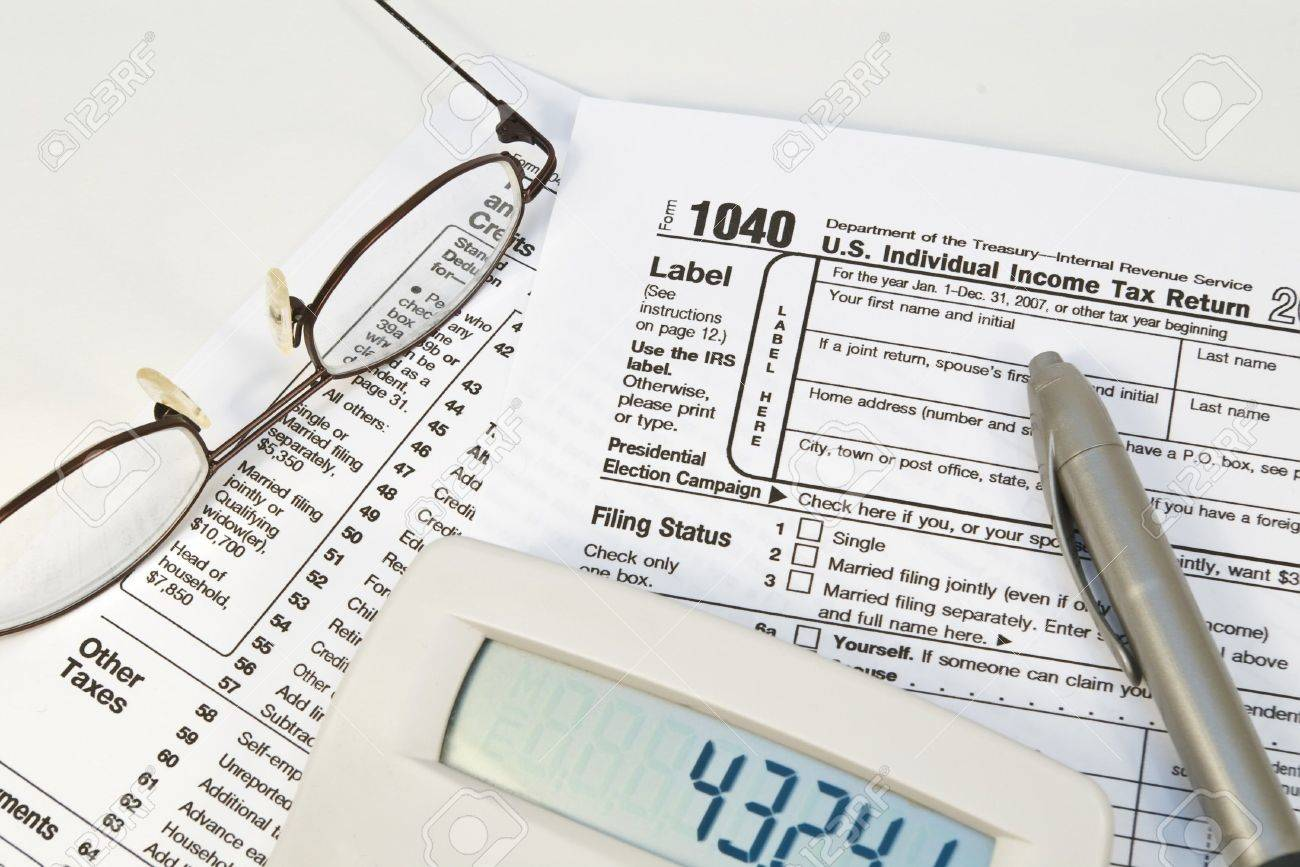 Irs 1040 form with glasses pen and calculator stock photo picture irs 1040 form with glasses pen and calculator stock photo 2205642 falaconquin