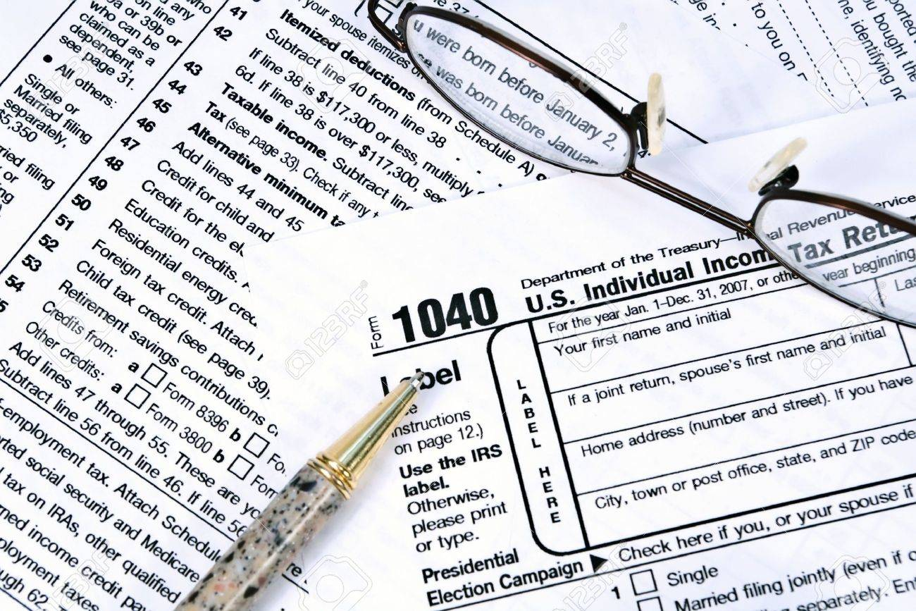 Irs 1040 Income Tax Forms With A Pair Of Glasses And A Pen Stock Photo :