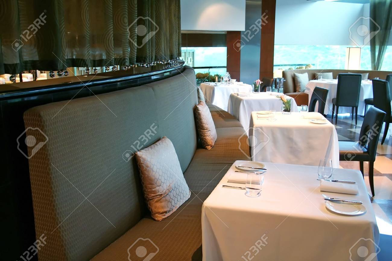 Tables set with plates and forks in a fancy restaurant Stock Photo - 1365426