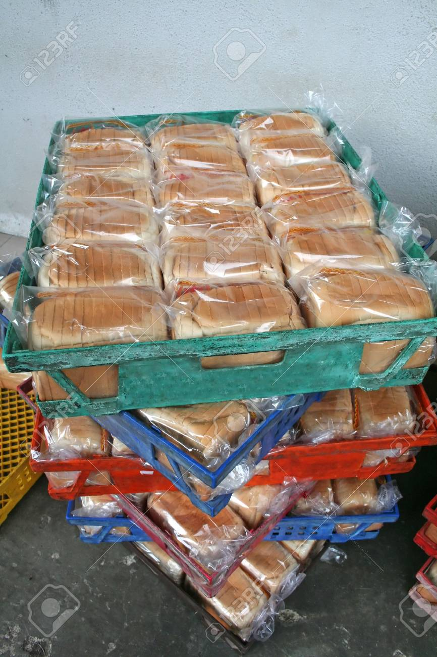 Rows of bread loaves in racks in a bakery Stock Photo - 1499089