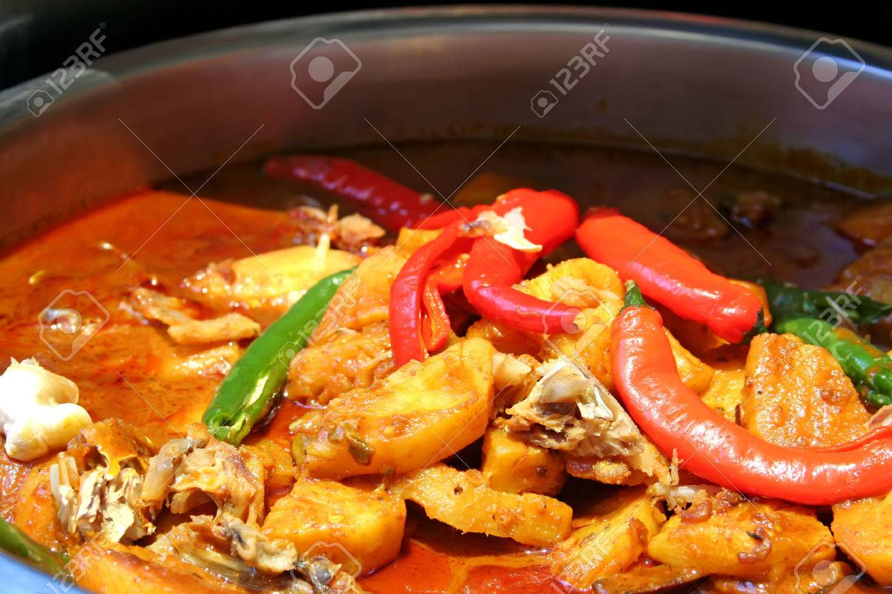 Spicy chicken curry with potatoes in serving dish Stock Photo - 1629622
