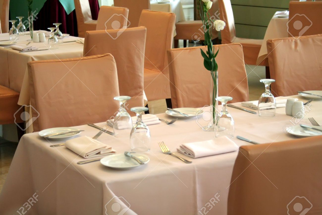 Restaurant table setting ideas - Elegant Restaurant Dining Table Setting With Cutlery Stock Photo 1842510