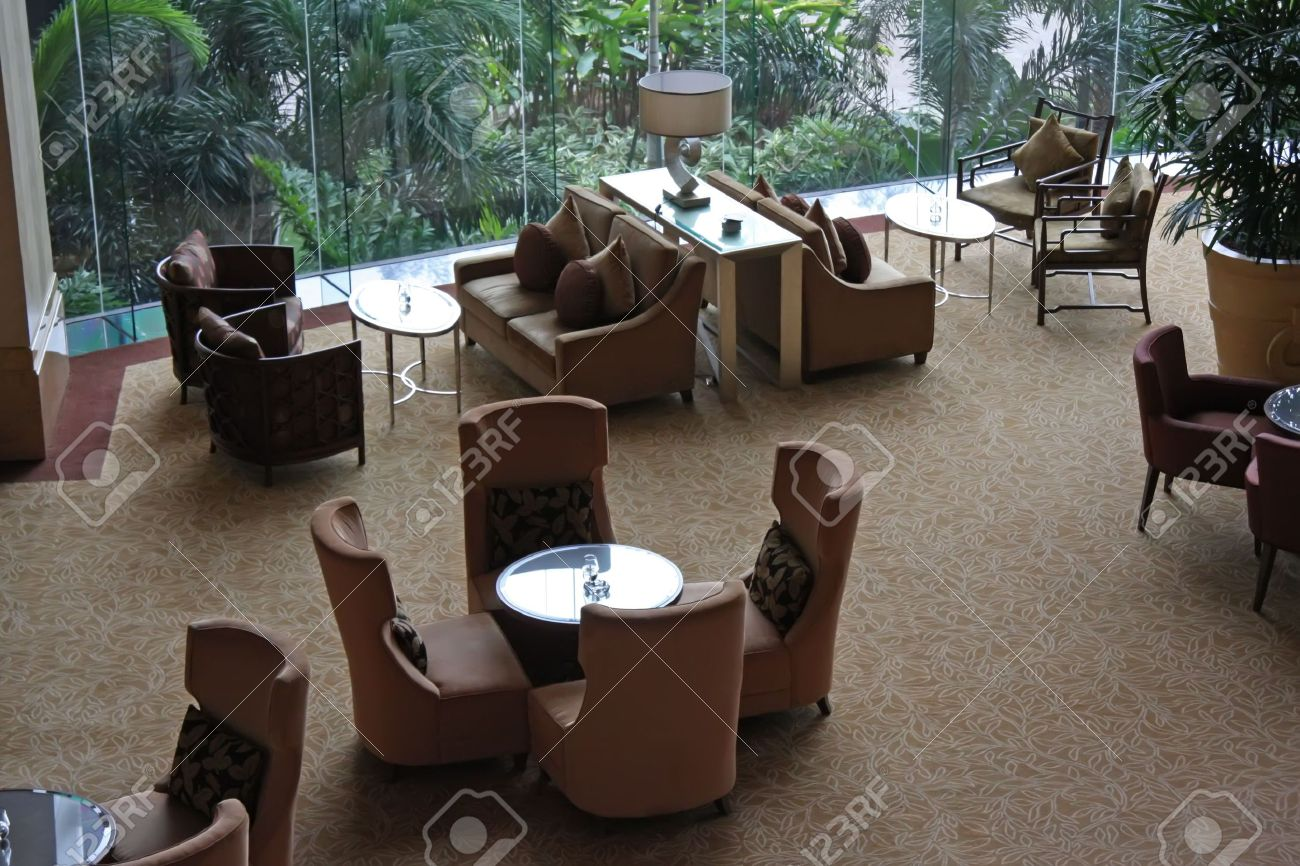 Elegant cafe lounge waiting area with tables and sofas Stock Photo - 2048795