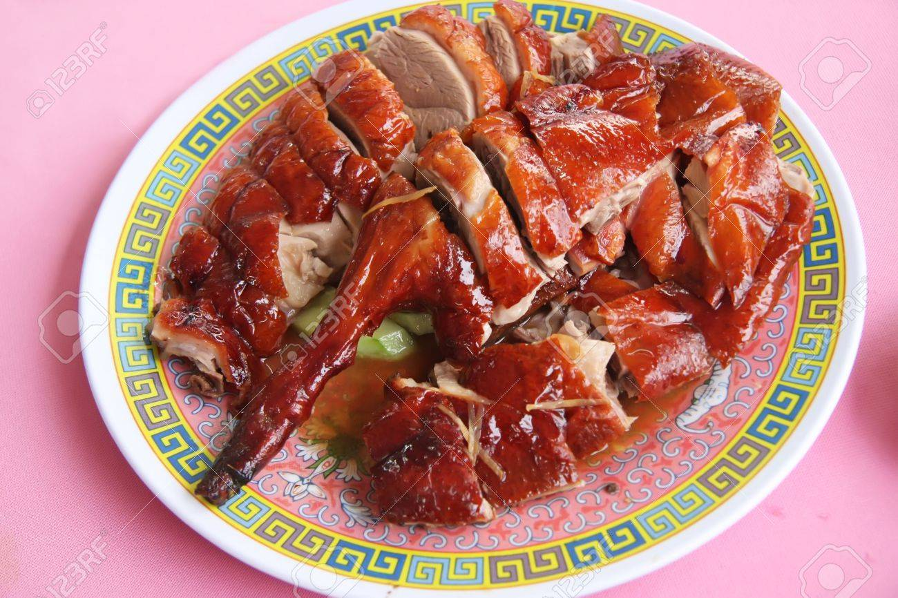 Roast duck chinese cuisine sliced portions on plate Stock Photo - 2378943
