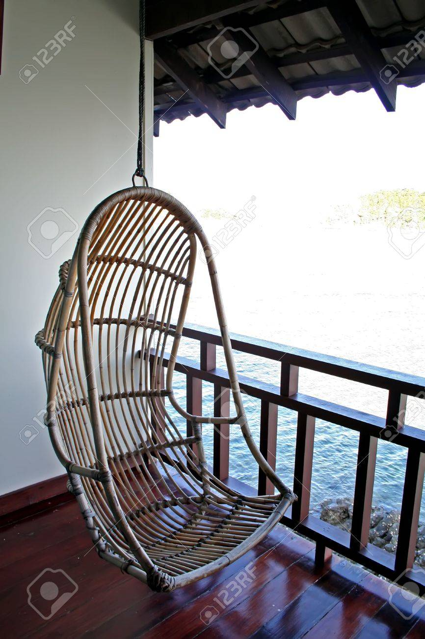 Attirant Hanging Chair In A Balcony With Seaside View Stock Photo   2404332