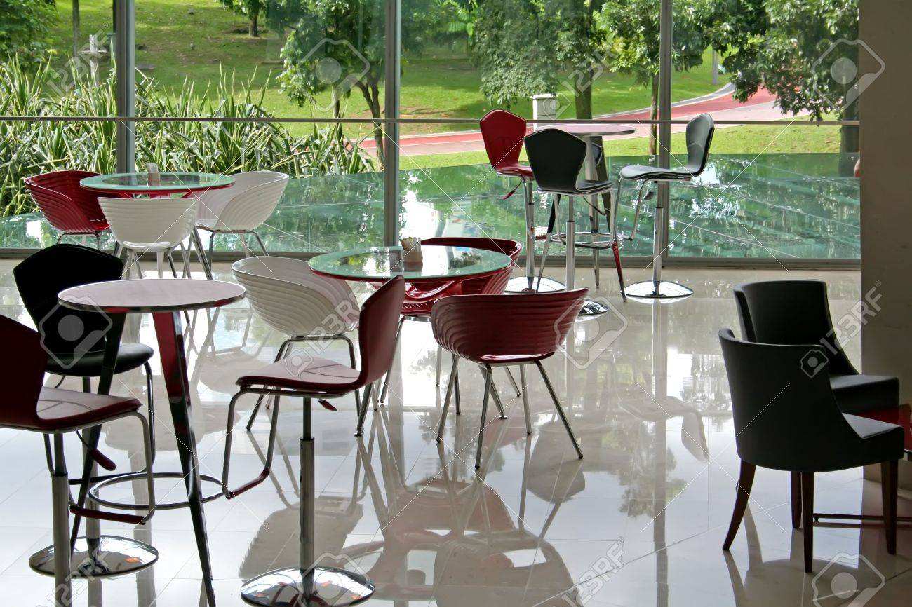 Modern cafe chairs and tables - Stock Photo Trendy Modern Cafe With Red Chairs And A Balcony View