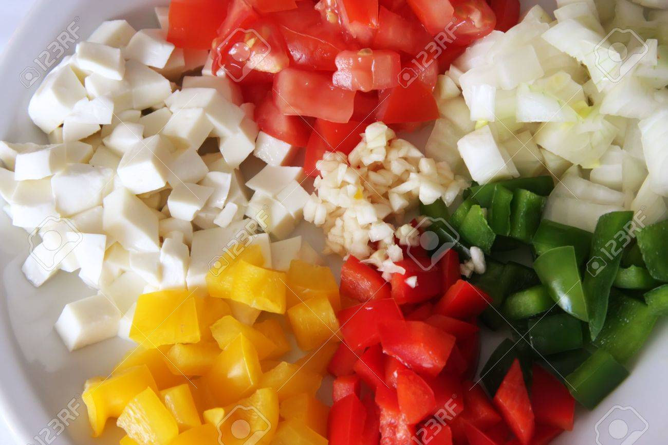 Chopped tomatoes, capsicums, mozarella, onions, garlic, Italian cooking ingredients Stock Photo - 3216650