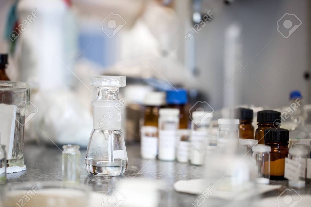 Flasks with liquids in a lab, pharmaceutical industry factory and production laboratory - 148534539