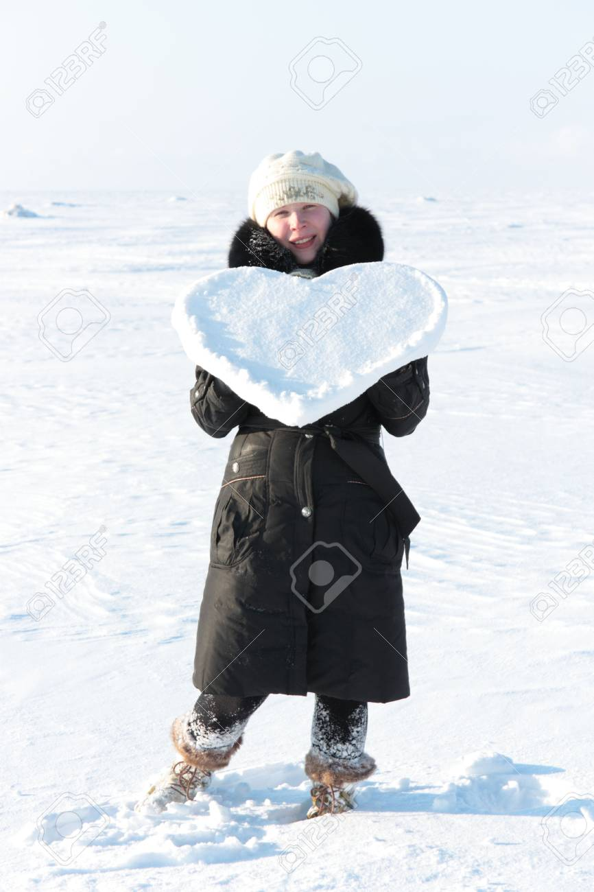 A girl holds a heart of ice. Stock Photo - 6509899