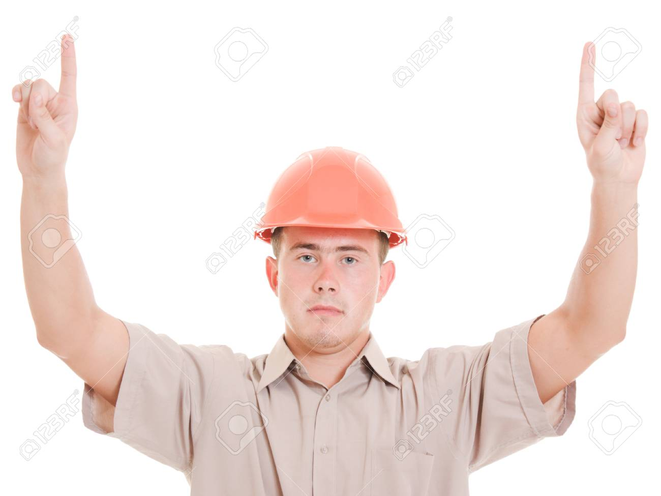 Businessman in helmet pointing up. Stock Photo - 11181625