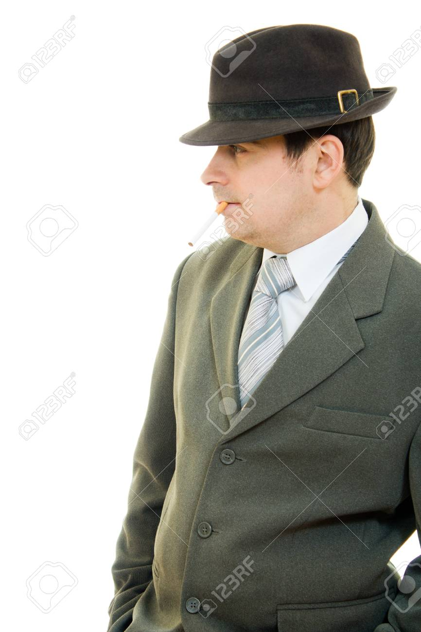 A businessman in a hat smokes on a white background. Stock Photo - 12036632
