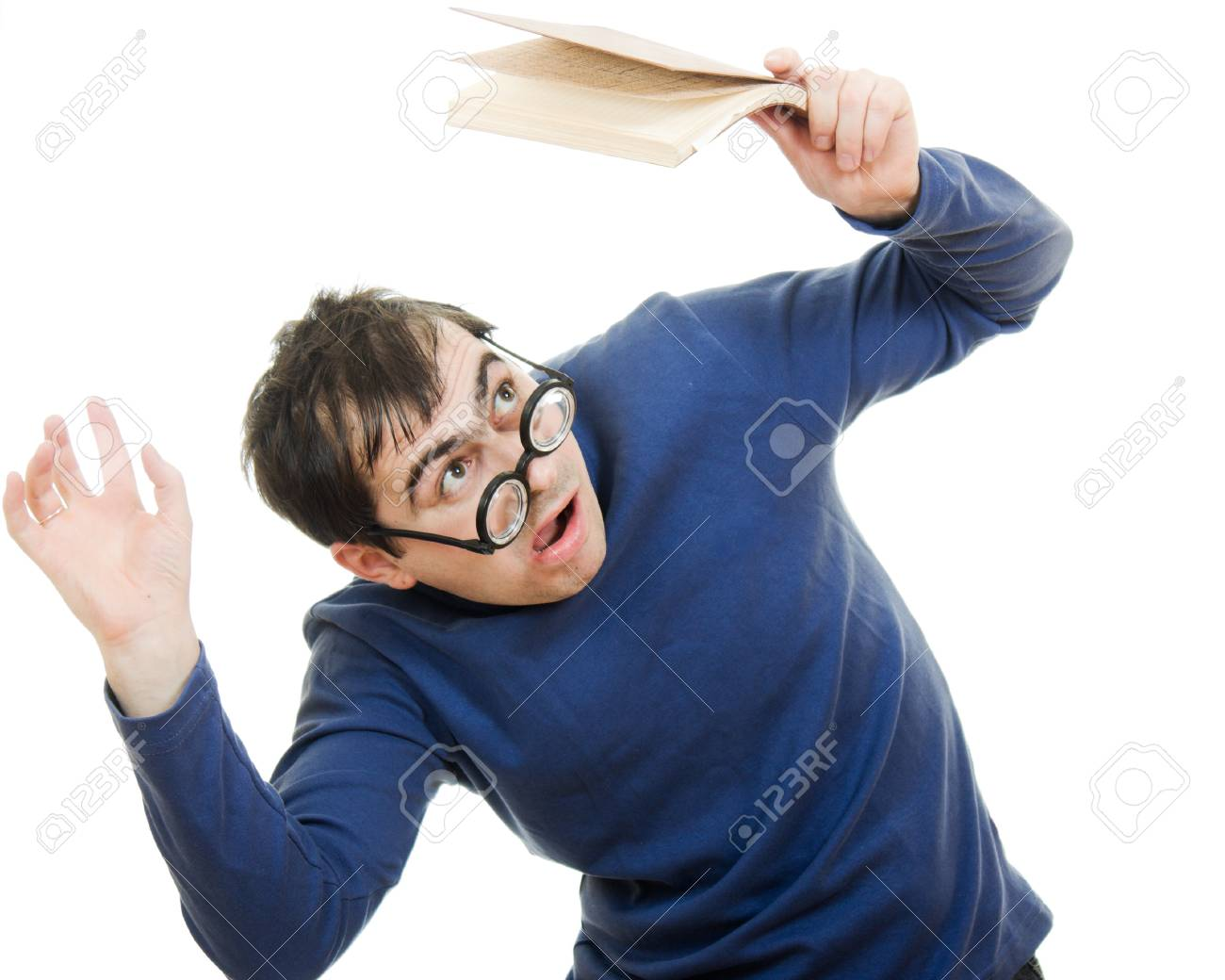 Student in glasses with a book over his head on white background Stock Photo - 12388094