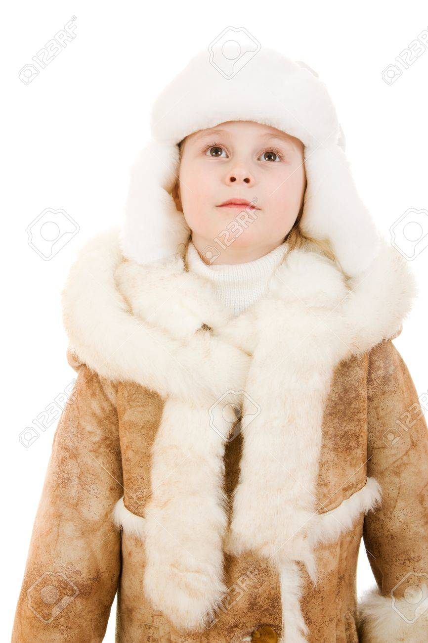 Girl In A Sheepskin Coat And Hat Looking Up On White Background ...