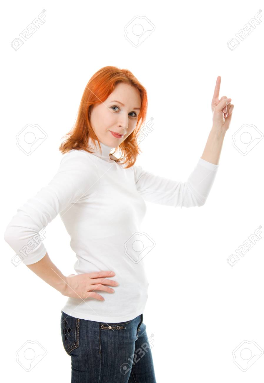 A beautiful girl with red hair shows thumb up on a white background. Stock Photo - 12712070