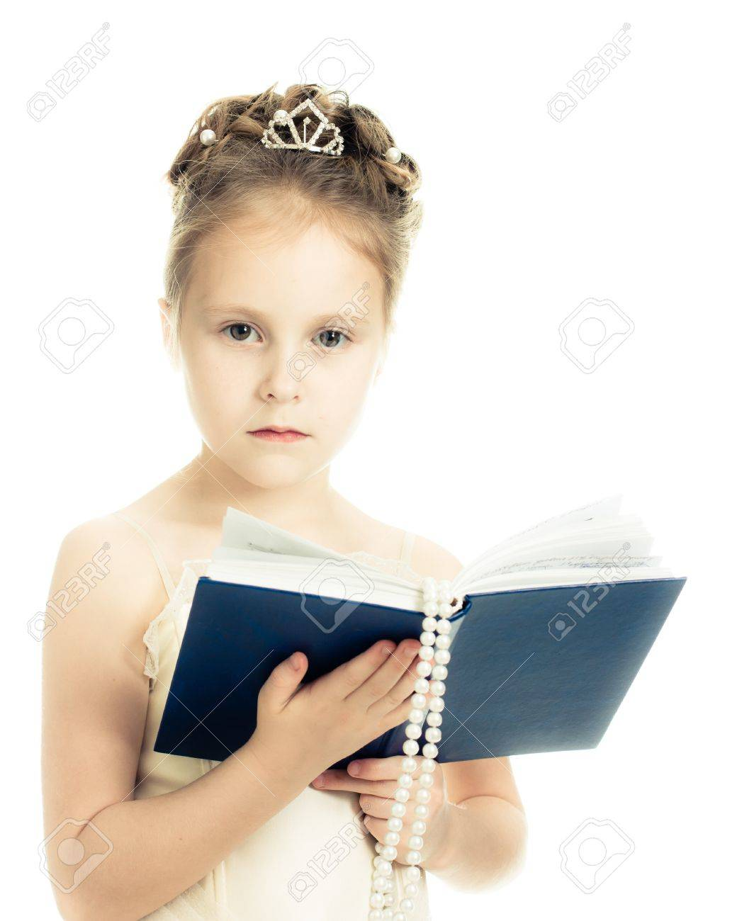 Pretty beautiful girl with a prayer book and a rosary on a white background. Stock Photo - 16640200