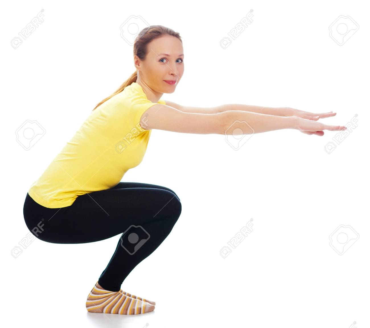 Young woman doing yoga exercise on a white background. Stock Photo - 19193954