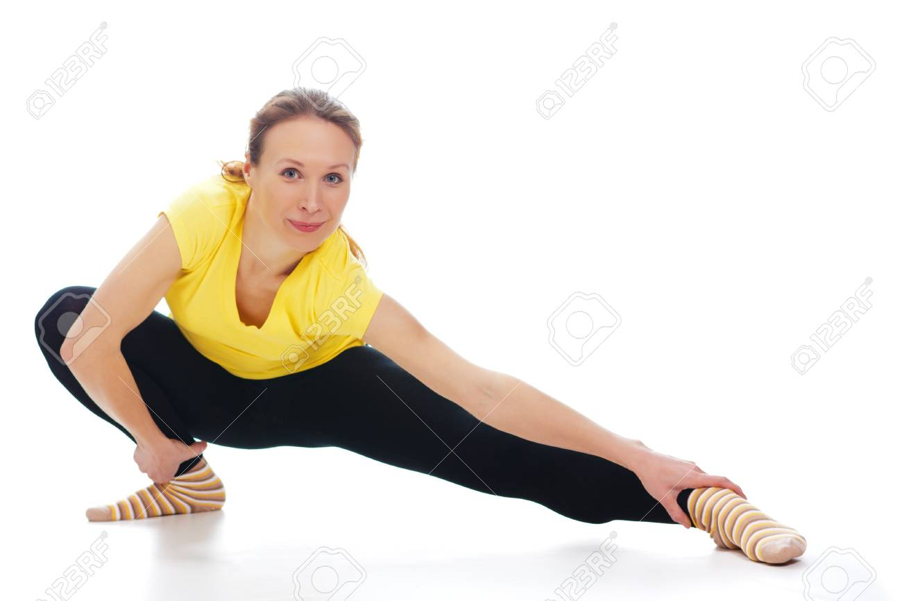 Young woman doing yoga exercise on a white background. Stock Photo - 19193962