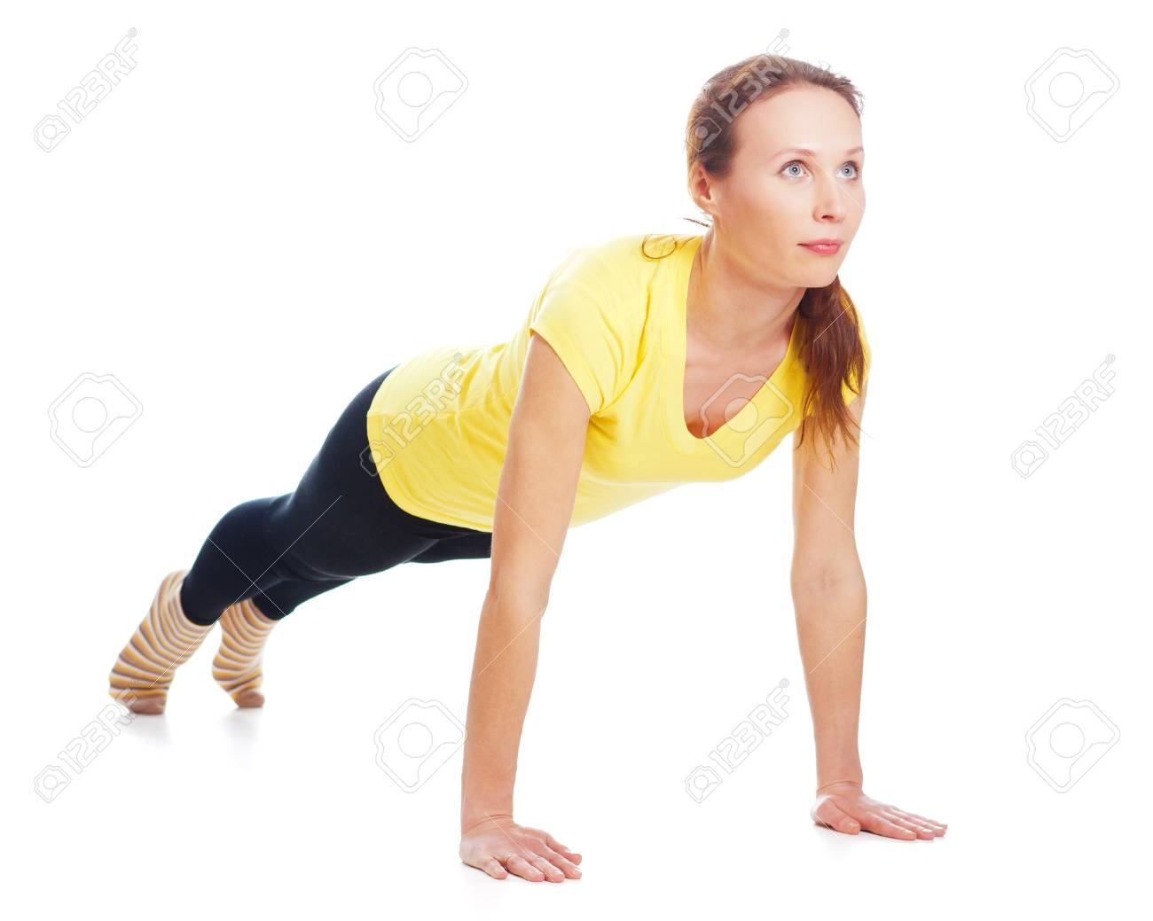 Young woman doing yoga exercise on a white background. Stock Photo - 19193969