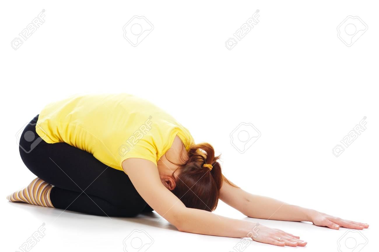 Young woman doing yoga exercise on a white background. Stock Photo - 19193960