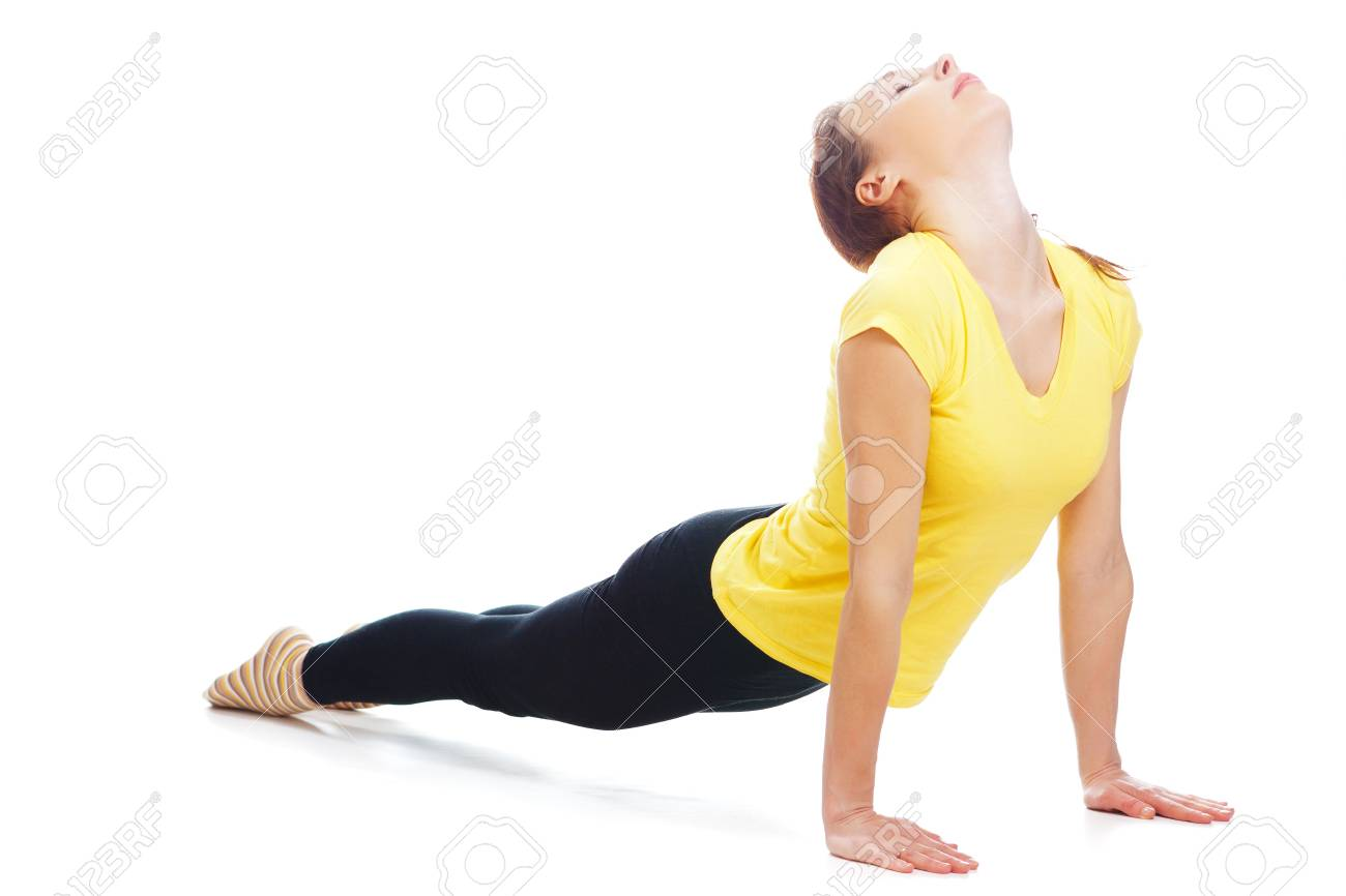 Young woman doing yoga exercise on a white background. Stock Photo - 19193981
