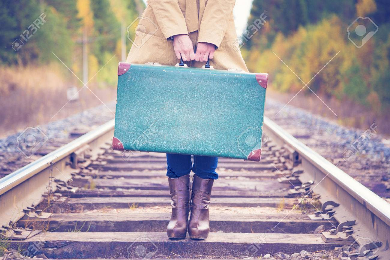 Elegant woman with a suitcase traveling by rail autumn day. - 50407164