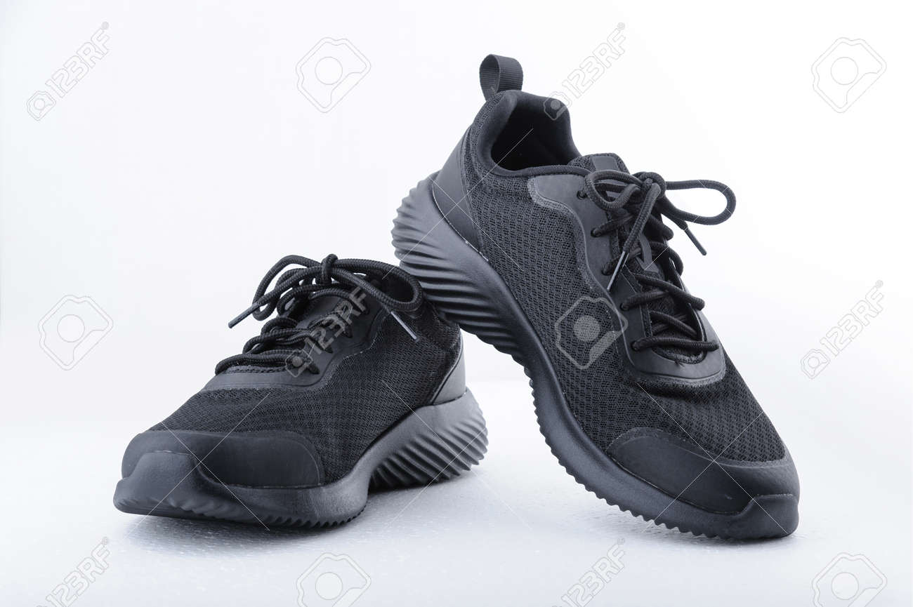 Black sport shoes isolated on white background. Closeup - 161965555