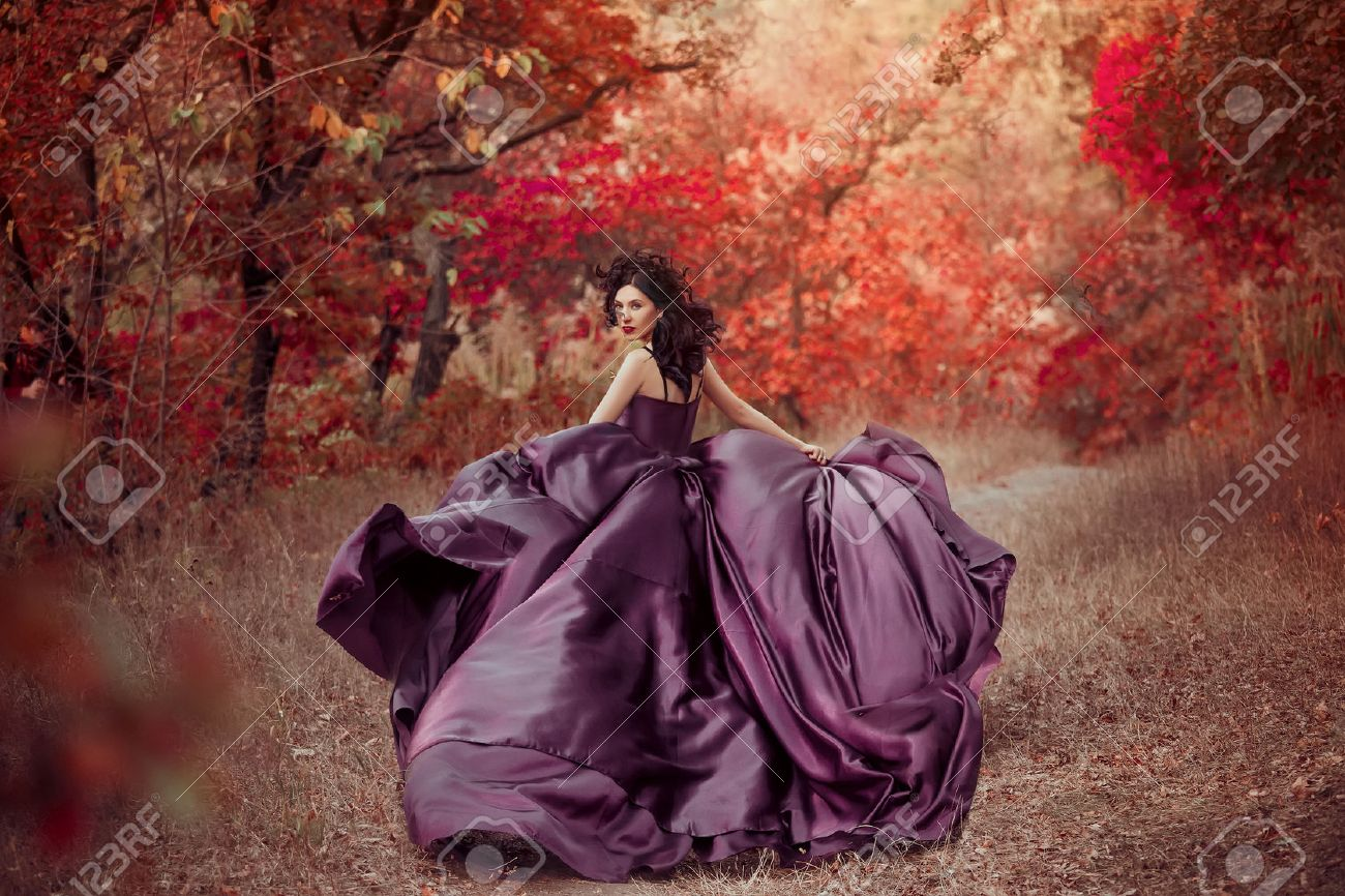 Lady in a luxury lush purple dress ,fantastic shot,fairytale princess is walking in the autumn forest,fashionable toning,creative computer colors - 52505440