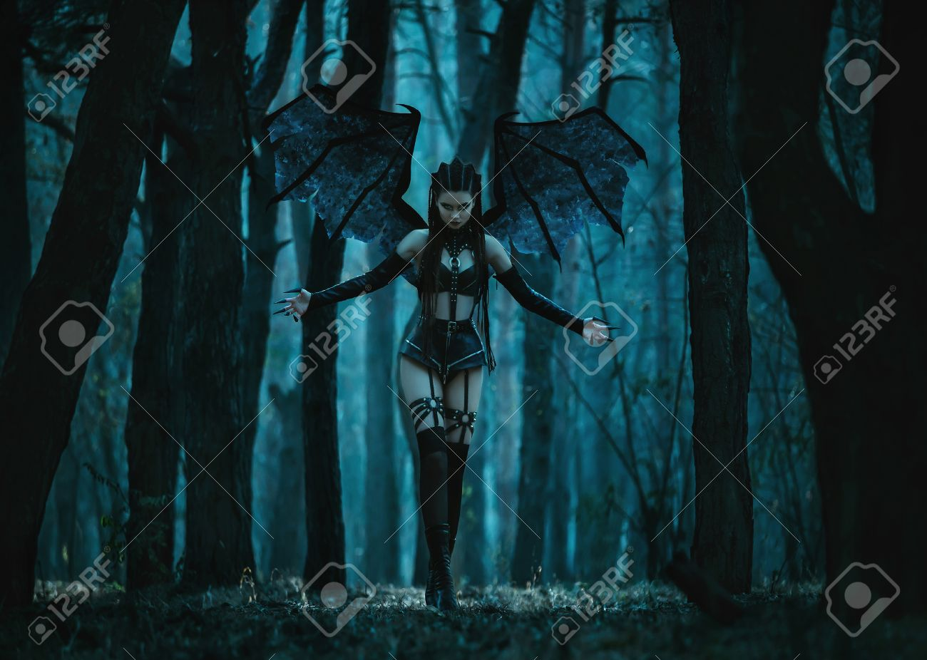 Girl vampire, a demon with bat wings, a succubus,through the dark forest girl walking a bat with huge wings and outfit,fashionable toning,creative computer colors - 52439045