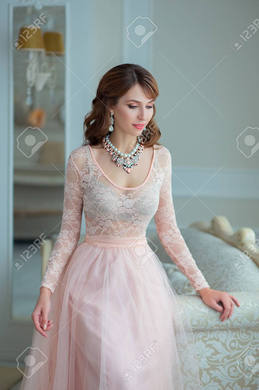 Beautiful Girl With Makeup And Styling In Pastel Peach Dress.. Stock ...