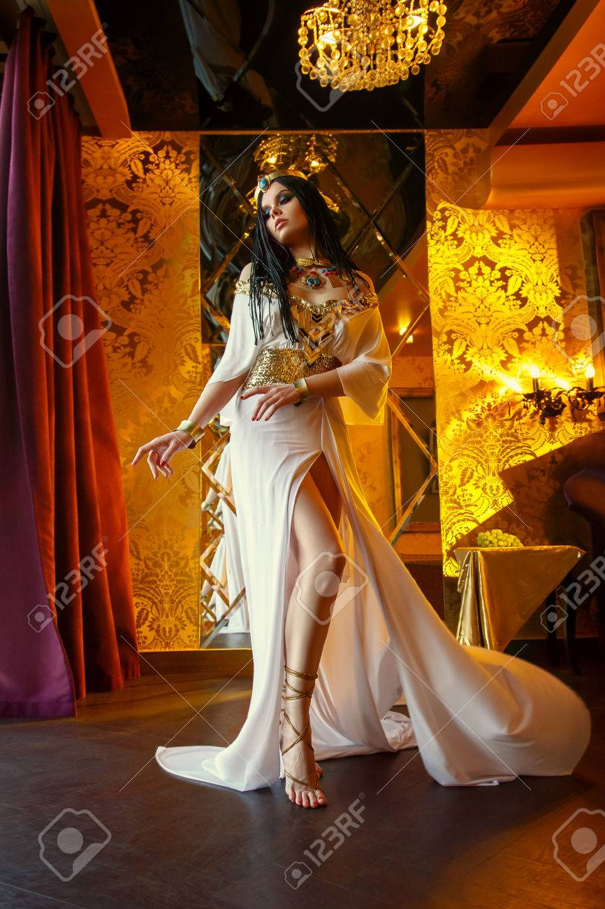 Stock Photo - Young queen in the rich chambers. The girl is dressed in a Greek dress and gold jewelry with snakes and scarabs. & Young Queen In The Rich Chambers. The Girl Is Dressed In A Greek ...