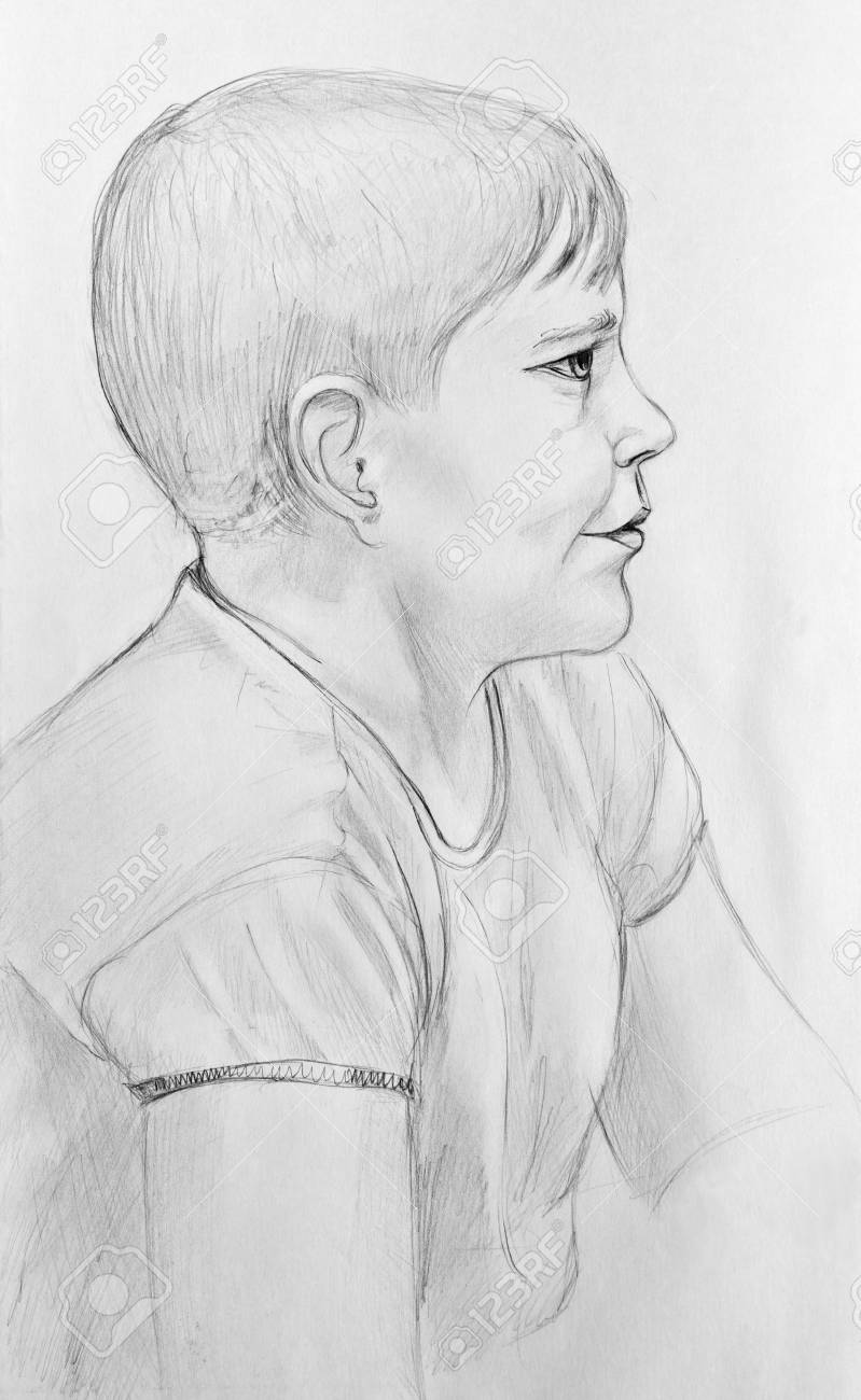 Portrait of a happy boy pencil drawing on paper