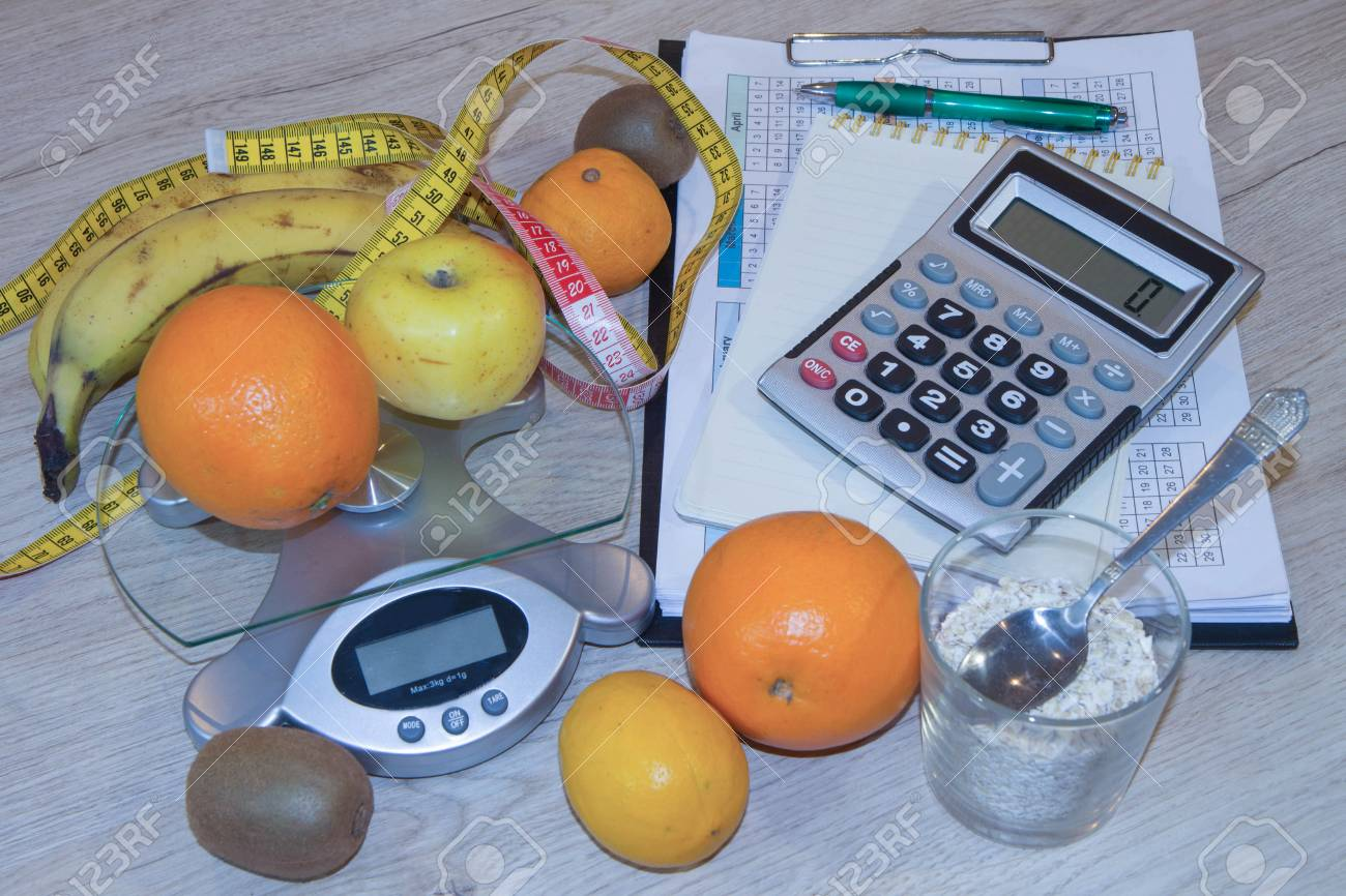 fruits and vitamins with measuring tape diet plan the concept