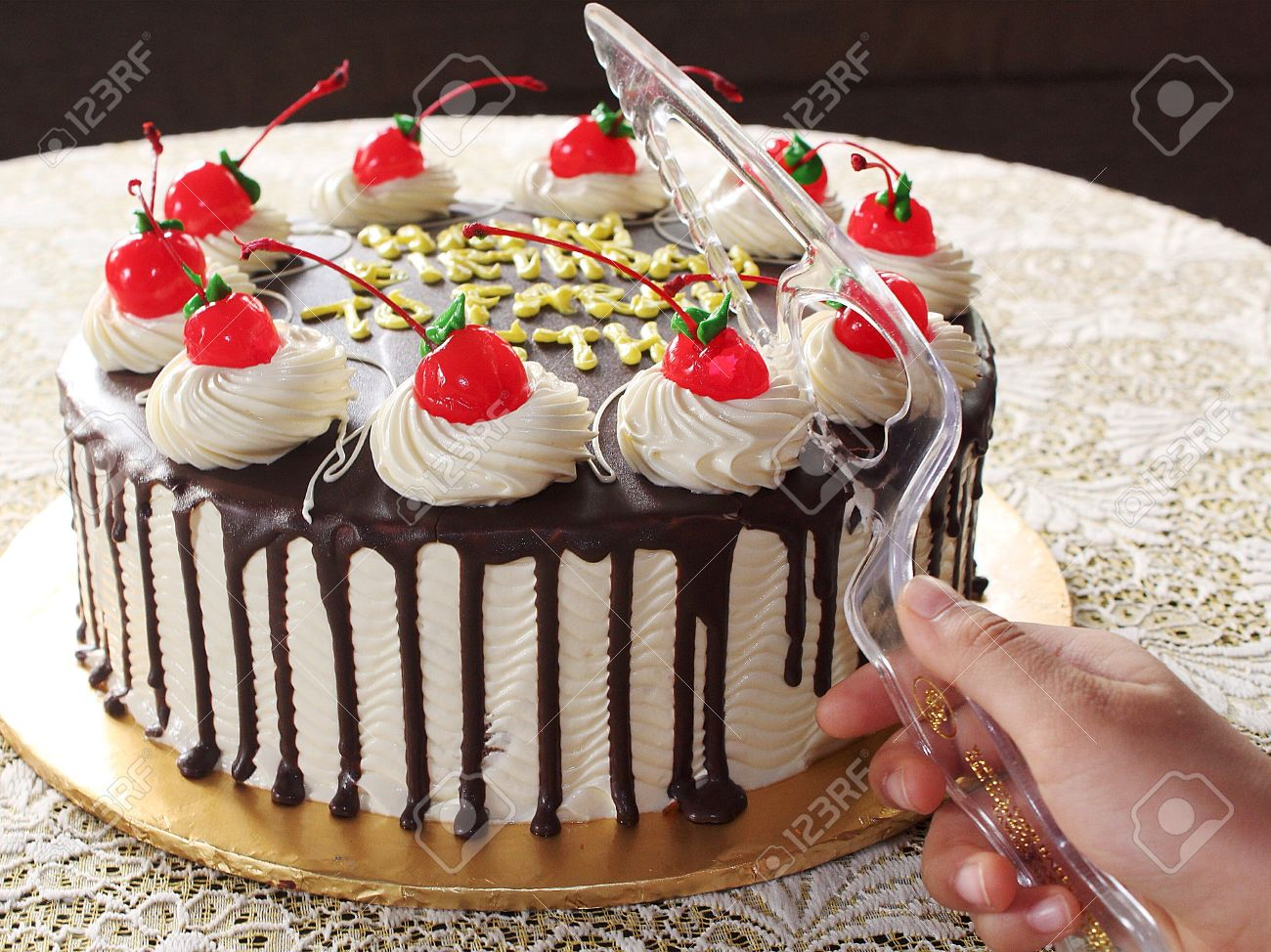 Birthday Cake Cut Using Plastic Knife Stock Photo