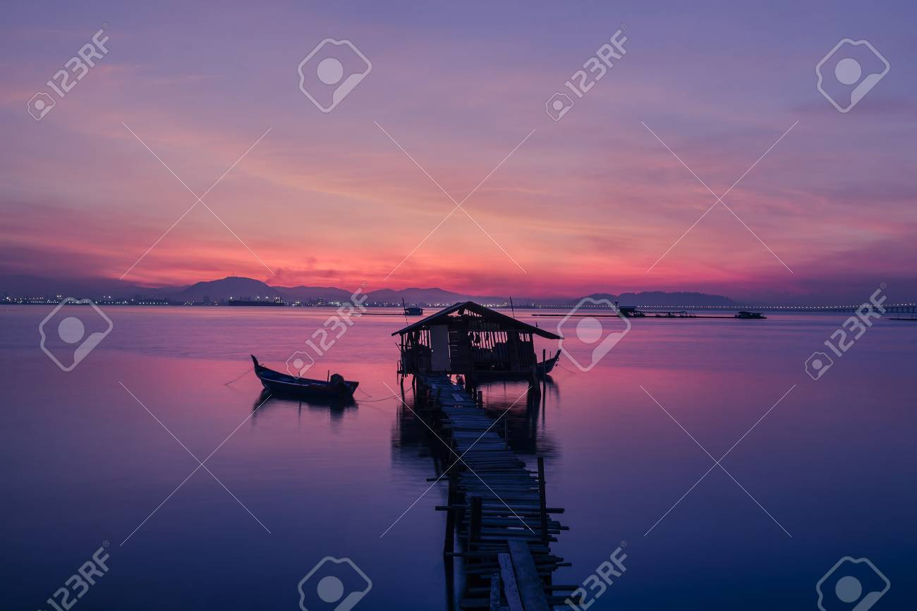 fisherman s cottage and pier at sunrise stock photo picture and