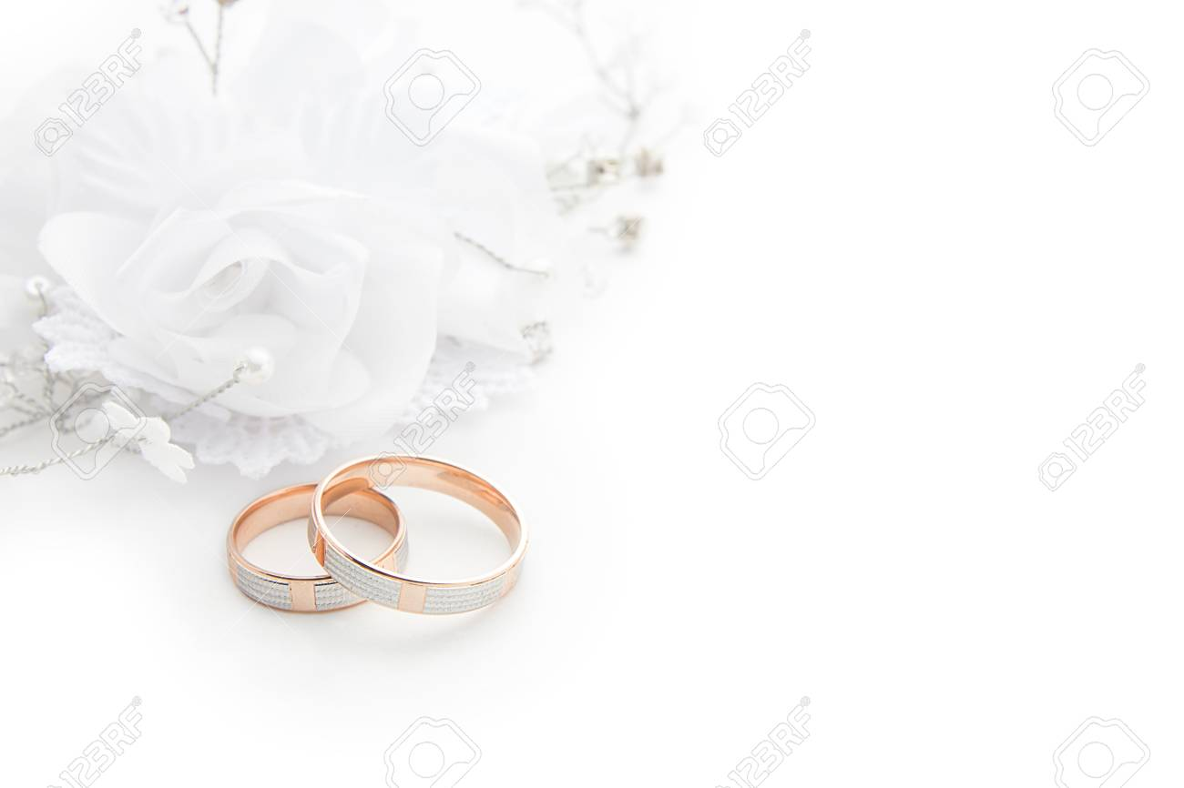 Wedding Rings On Wedding Card On A White Background Stock Photo