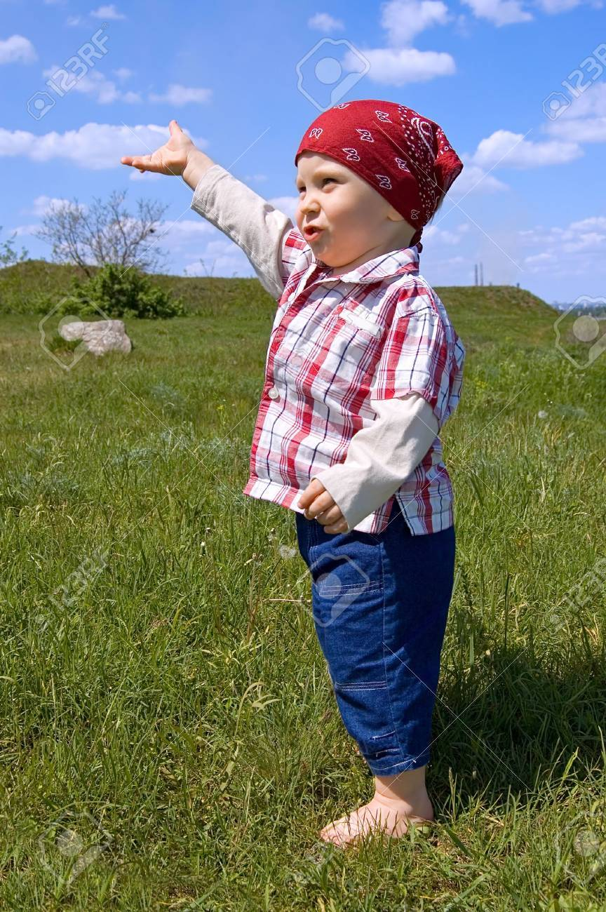 1,5 years old barefooted  boy to step out briskly against summer landscape Stock Photo - 2767505