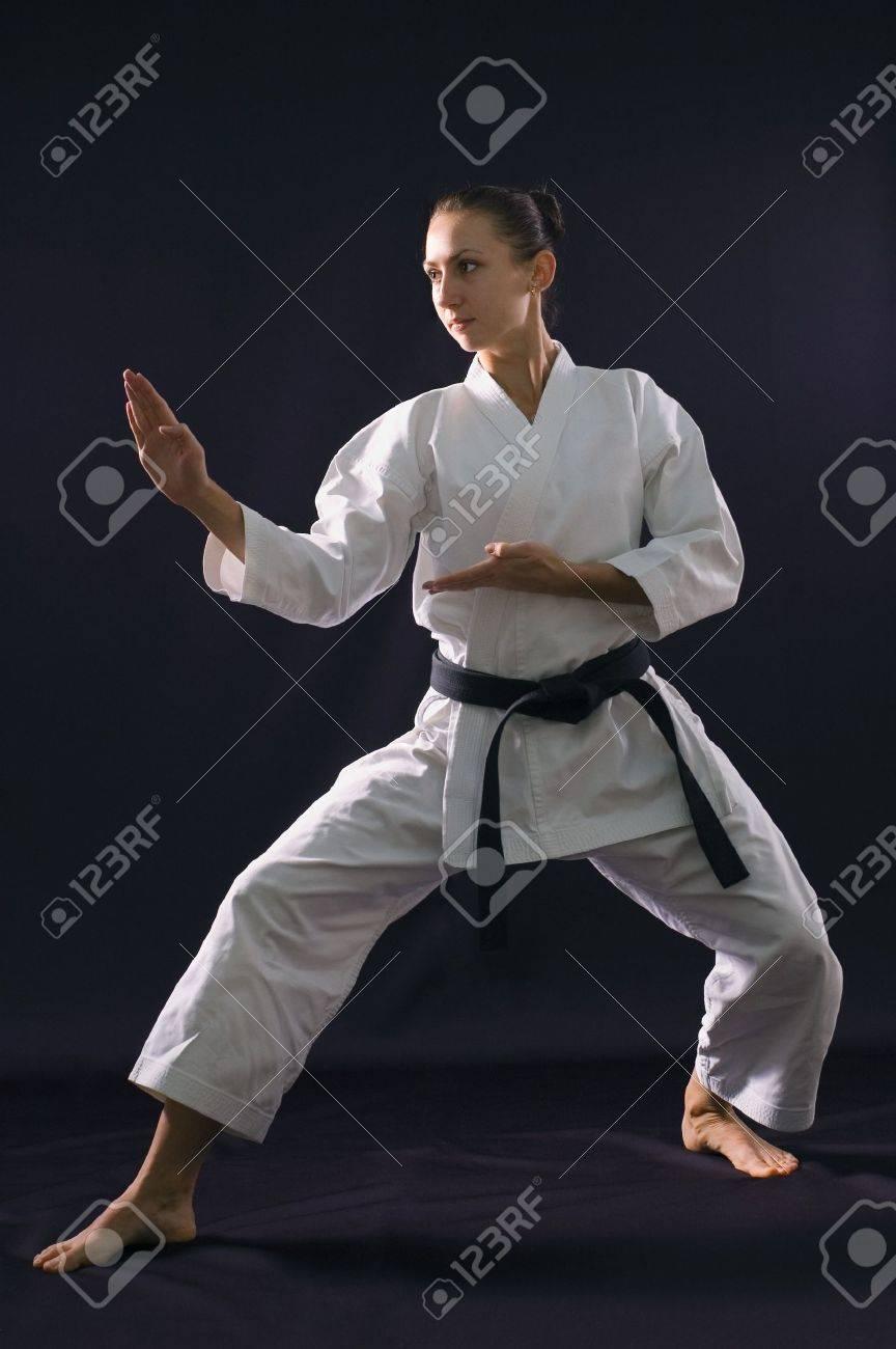 karateka girl on black background studio shot Stock Photo - 7017852