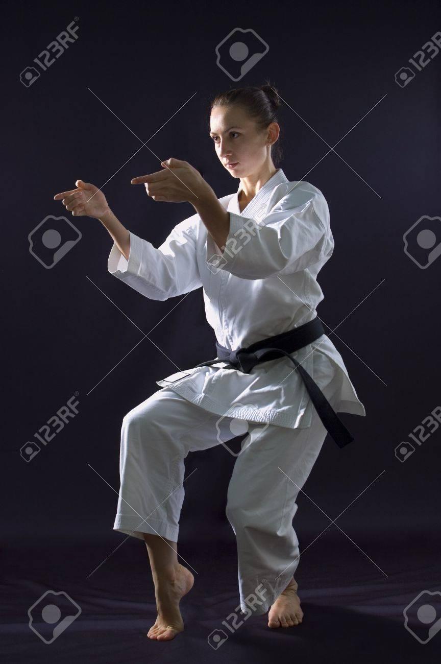 karateka girl on black background studio shot Stock Photo - 7017849