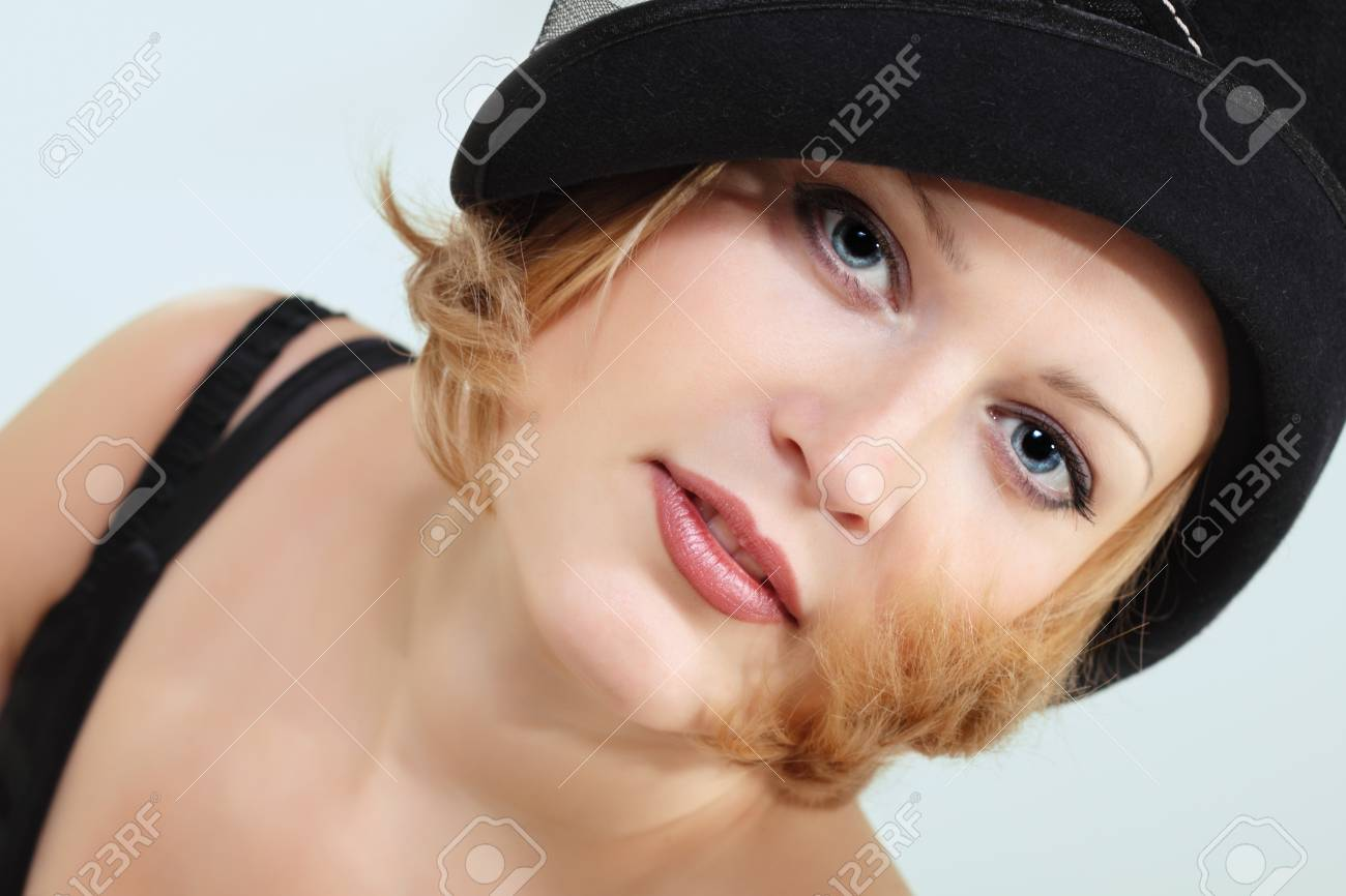lady charming with black hat over light background Stock Photo - 8323685