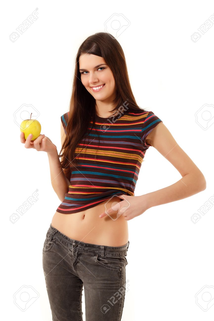 Bely teen Stock Photo - diet teen girl cheerful slim with apple show belly isolated on white background