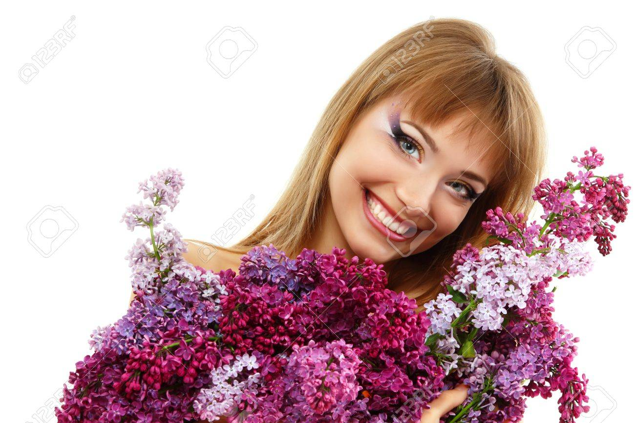 woman beautiful face with bunch flower lilac Stock Photo - 11736577