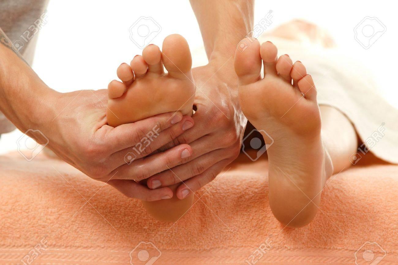 massage foot female close-up isolated on white background Stock Photo - 12809969
