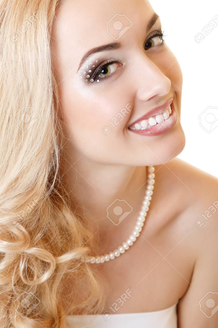 beauty portrait of young woman bride with beautiful makeup and and long blond hair over white background Stock Photo - 14695439