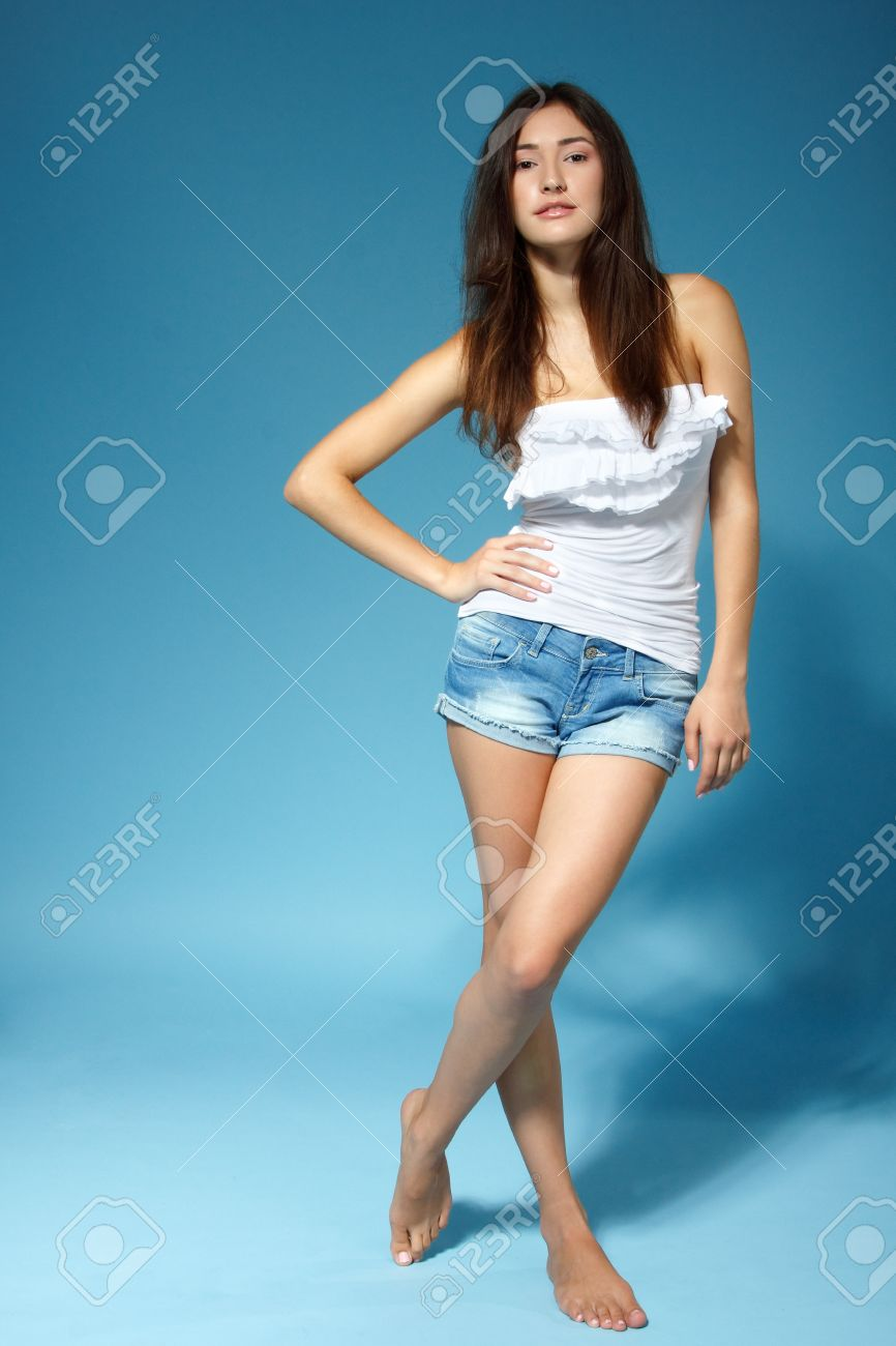 Beautiful Cheerful Teen Girl In Jean Shorts And White Top, Full ...