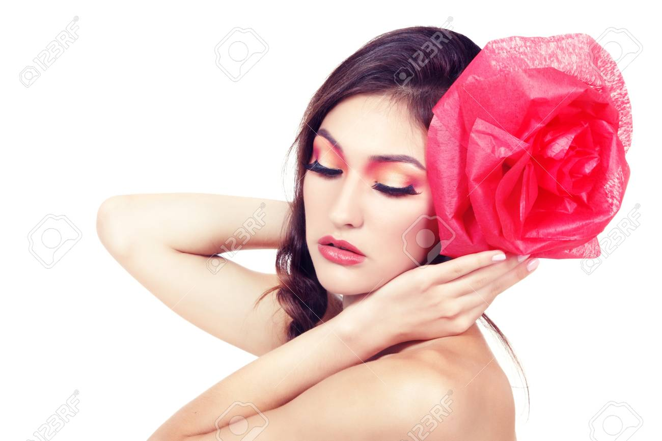 Vintage portrait of fashion glamour girl with red flower in her hair, over white. Studio shot Stock Photo - 17751699