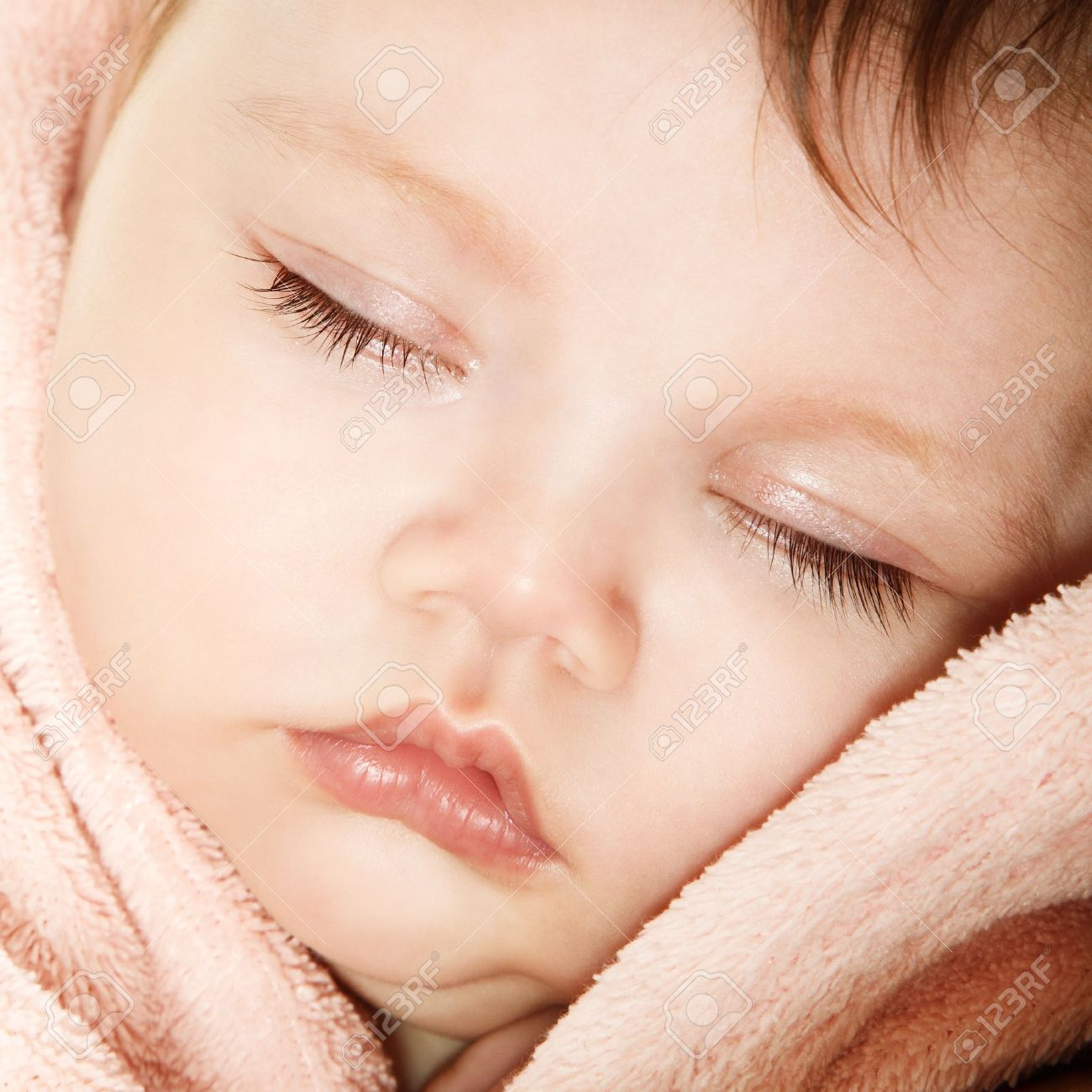 http://previews.123rf.com/images/kho/kho1303/kho130300075/18207665-cute-infant-baby-sleeping-beautiful-kid-s-face-closeup-studio-shot-Stock-Photo.jpg