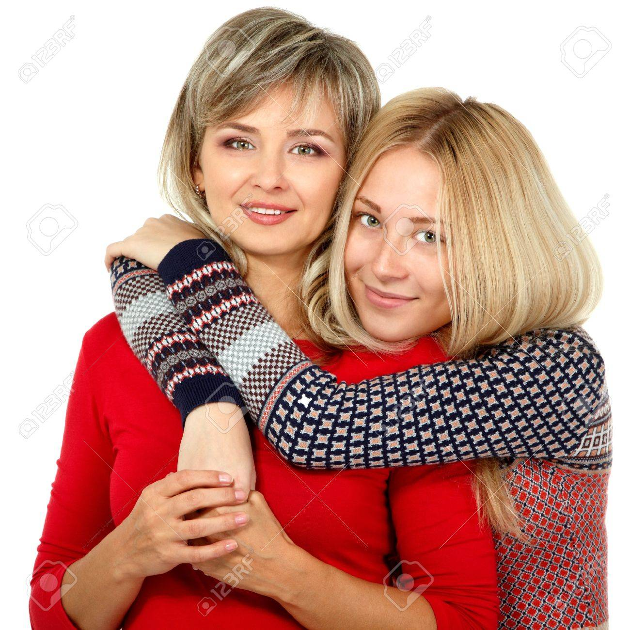 Mother and teen daughter winter portrait over white Stock Photo - 19086196