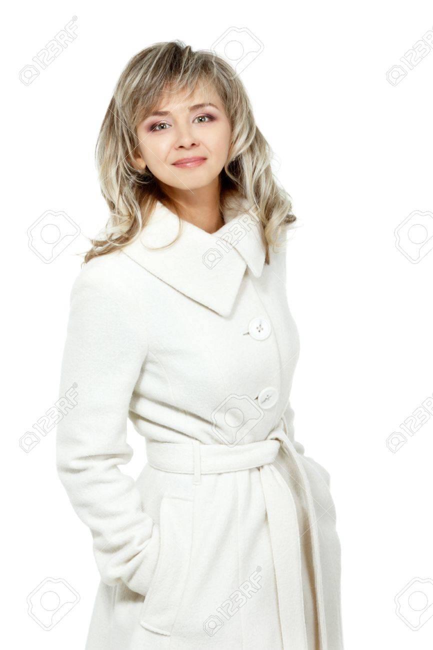 sitio de buena reputación 401fb 4aaa6 Retrato estacional de la alegre mujer de mediana edad, atractivo caucásico  40 años mujer en abrigo largo de color blanco